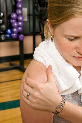 Woman with hurt shoulder