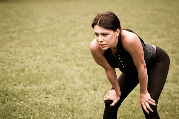 Woman with knee pain running