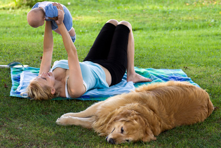 Woman with newborn and dog