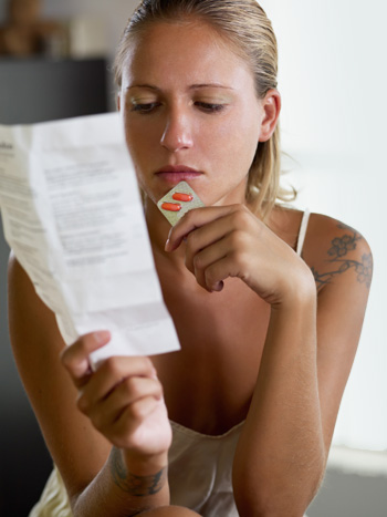 Woman with plan b pills