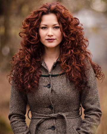 Woman with red hair in autumn
