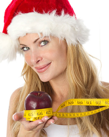 Woman dress for christmas with apple and tape measure | Sheknows.ca