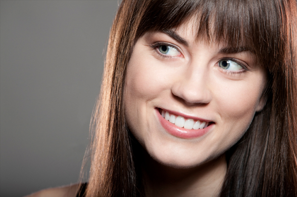 Woman with smooth, straight hair and bangs