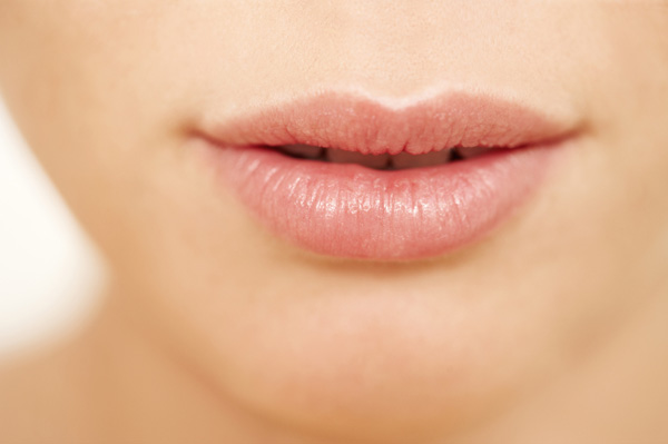 Woman with soft kissable lips