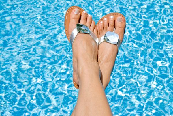 Woman with white nail polish at the pool
