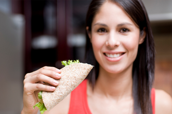 Woman with whole wheat wrap