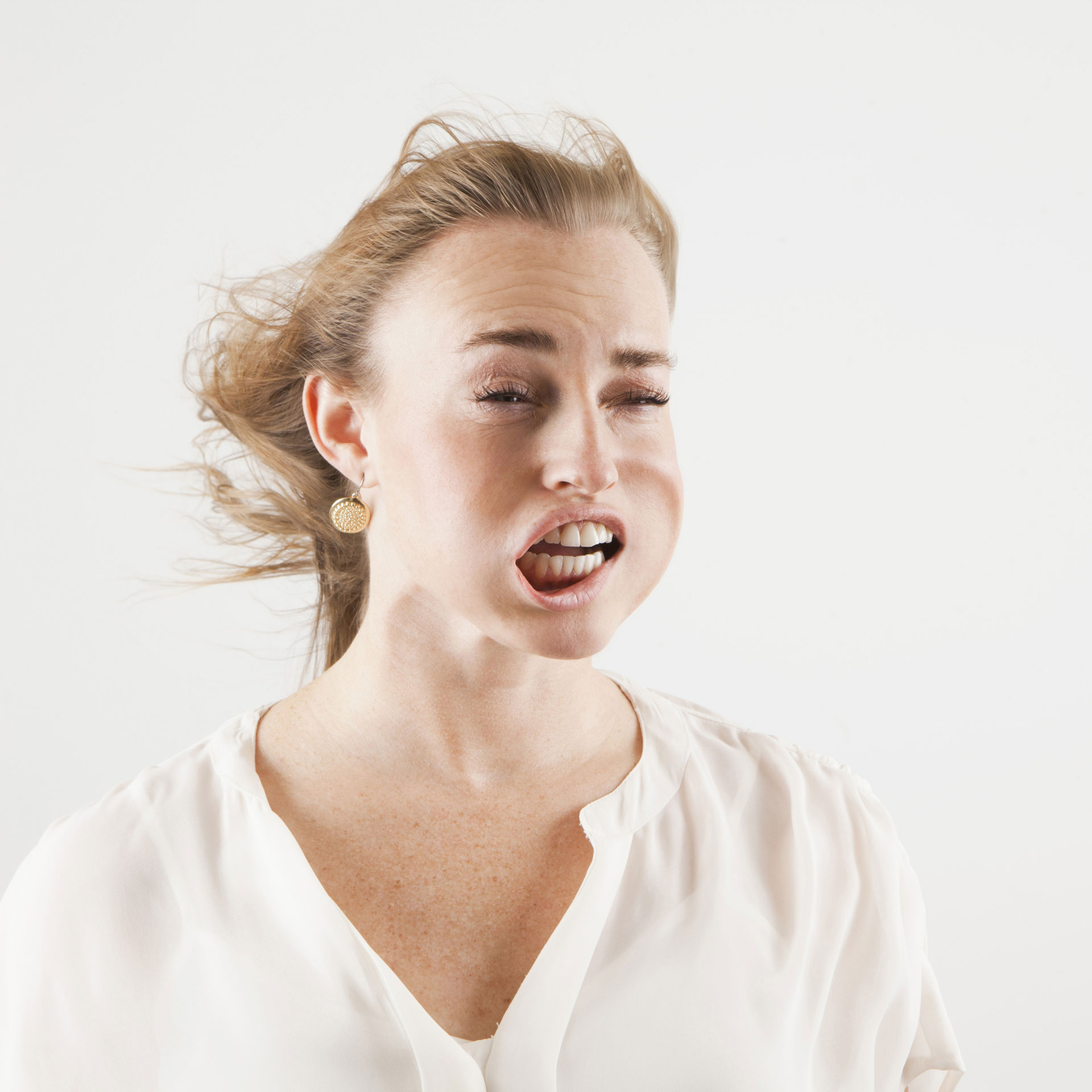 woman with windblown mouth