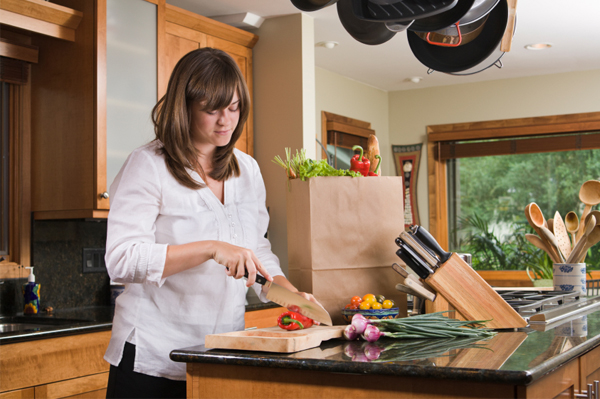 Woman with wooden cutting board