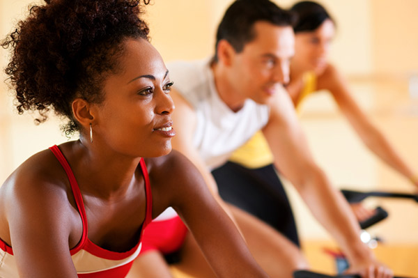 woman working out in cycling class