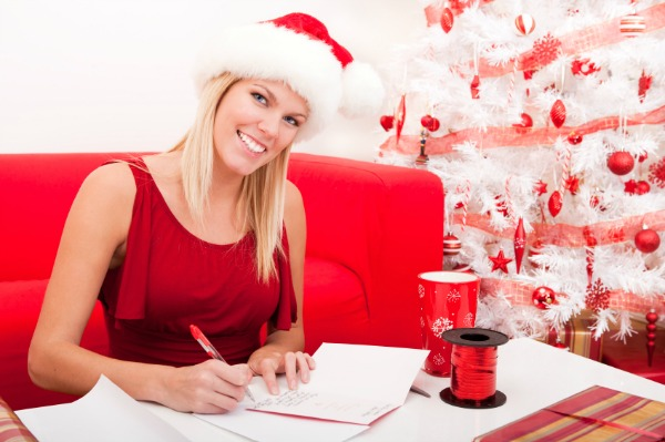 Woman addressing Christmas cards