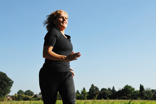 woman runing along a field