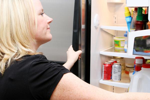 Woman looking in fridge