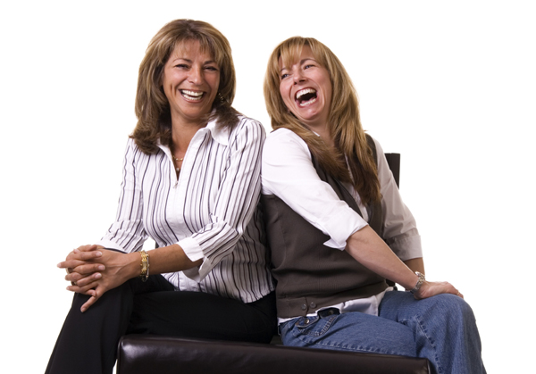 two woman laughing together