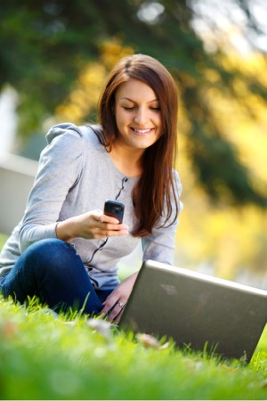 woman turning on mobile hotspot for laptop