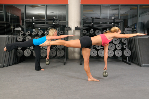 Woman doing kettlebells