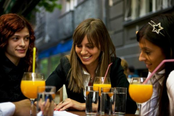 Women having drinks on an outdoor patio