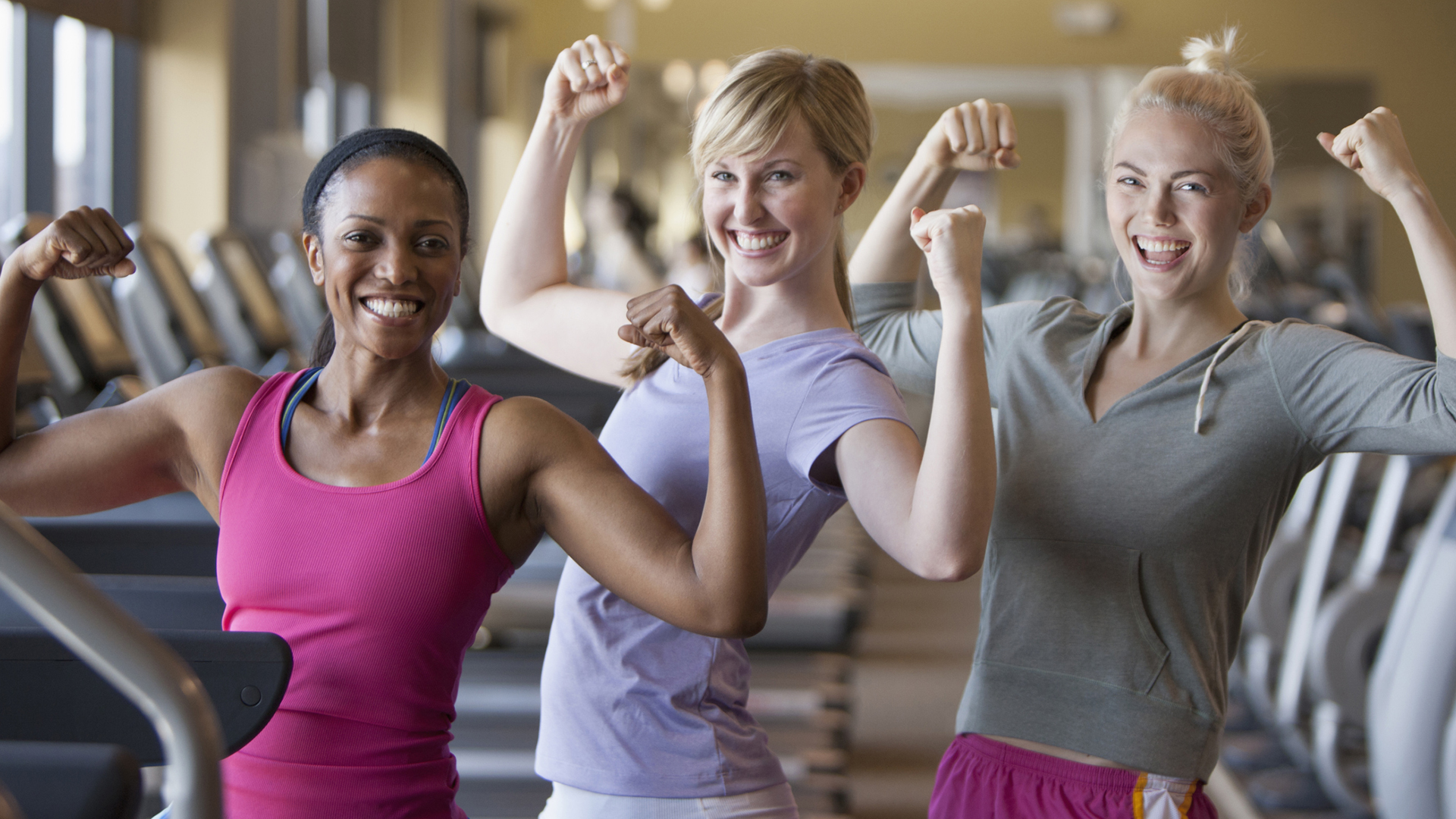 Women flexing arms at gym | Sheknows.ca