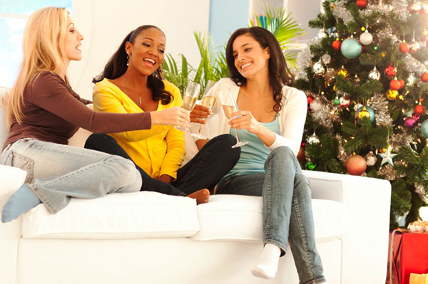 Women toasting at a Christmas open house | Sheknows.ca