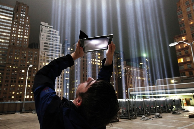 Frank Hollenkamp uses his iPad to shoot video of the Tribute in Lights