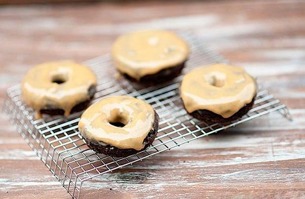 Peanut butter-glazed baked chocolate doughnuts