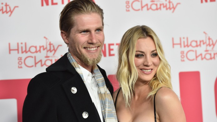 Karl Cook and Kaley Cuoco attend