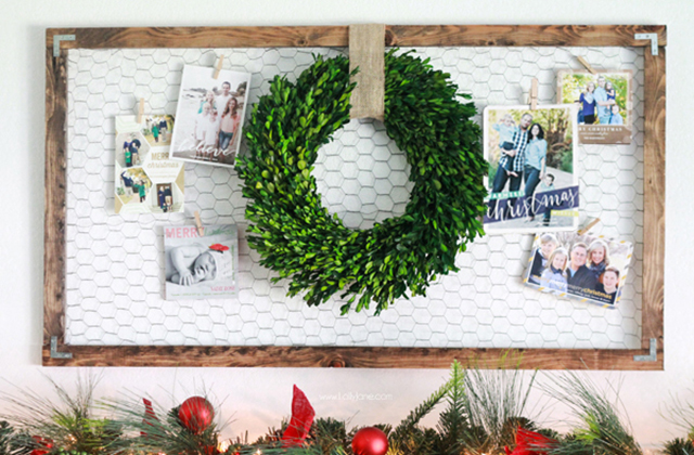 holiday card display with wreath