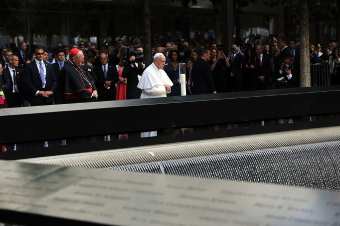Pope Francis pauses during a visit to Ground Zero