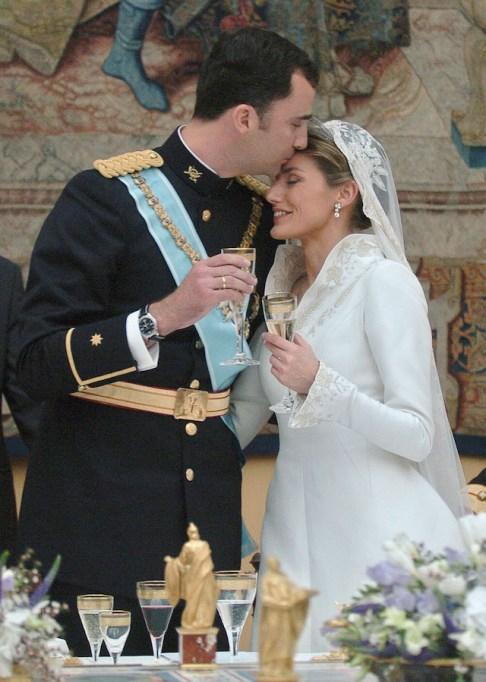 Prince Felipe de Bourbon & Princess Letizia Ortiz kiss on their wedding day