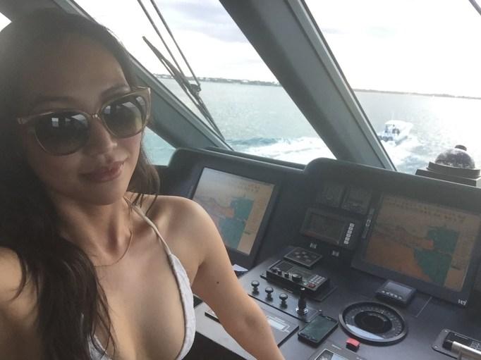 Dorothy Wang driving a boat
