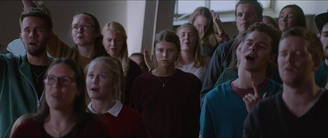 Still of Eili Harboe in a crowd of people in 'Thelma'