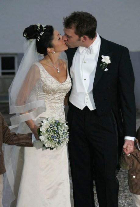 Princess Alexandra Christina of Denmark & Martin Jorgensen kiss on their wedding day