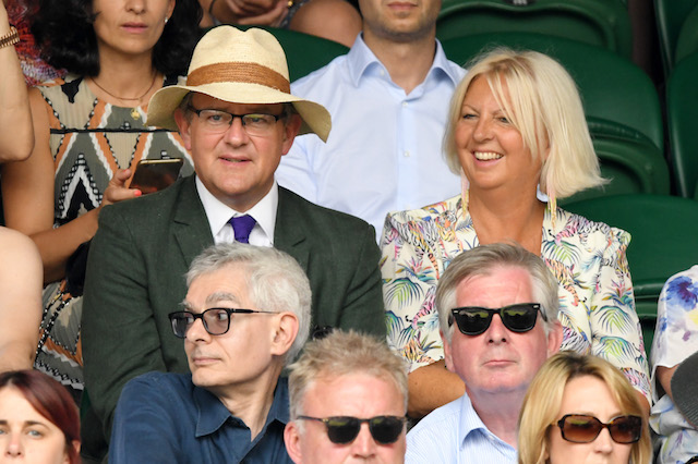 Hugh Bonneville and his wife, Lulu Evans, attend day seven of the Wimbledon Tennis Championships at the All England Lawn Tennis and Croquet Club