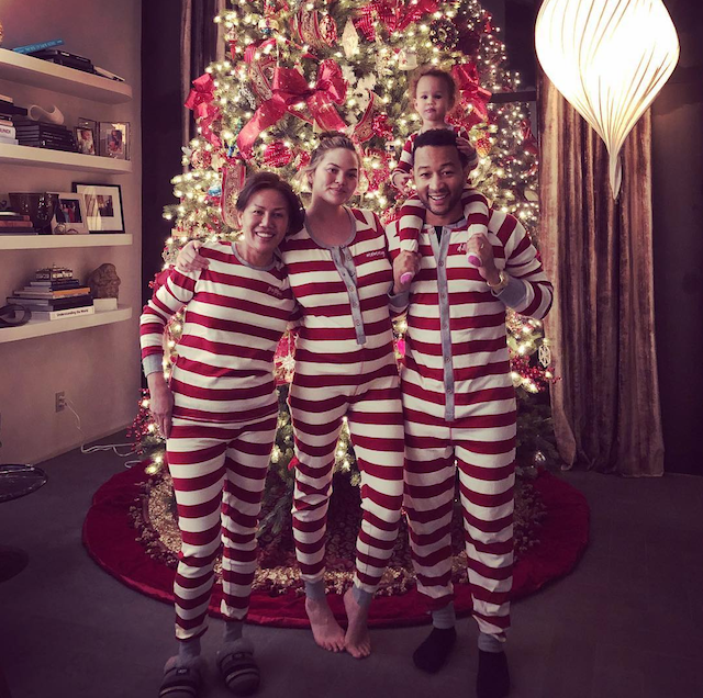 Chrissy Teigen with John Legend and her mother in red-and-white striped onesies
