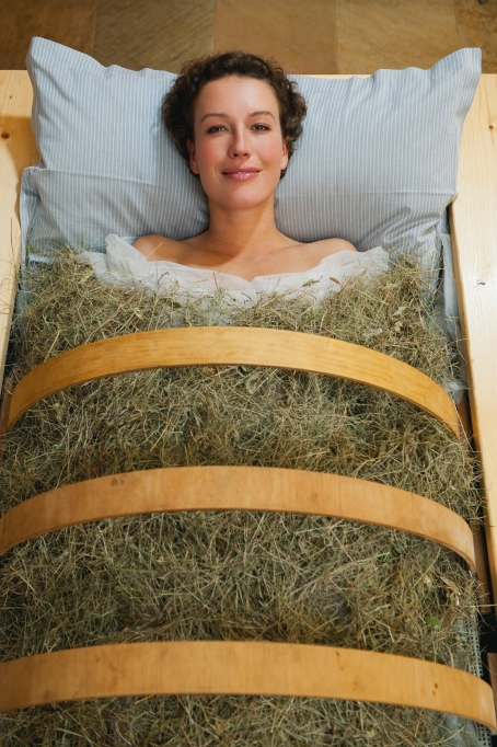 Woman in a hay bath