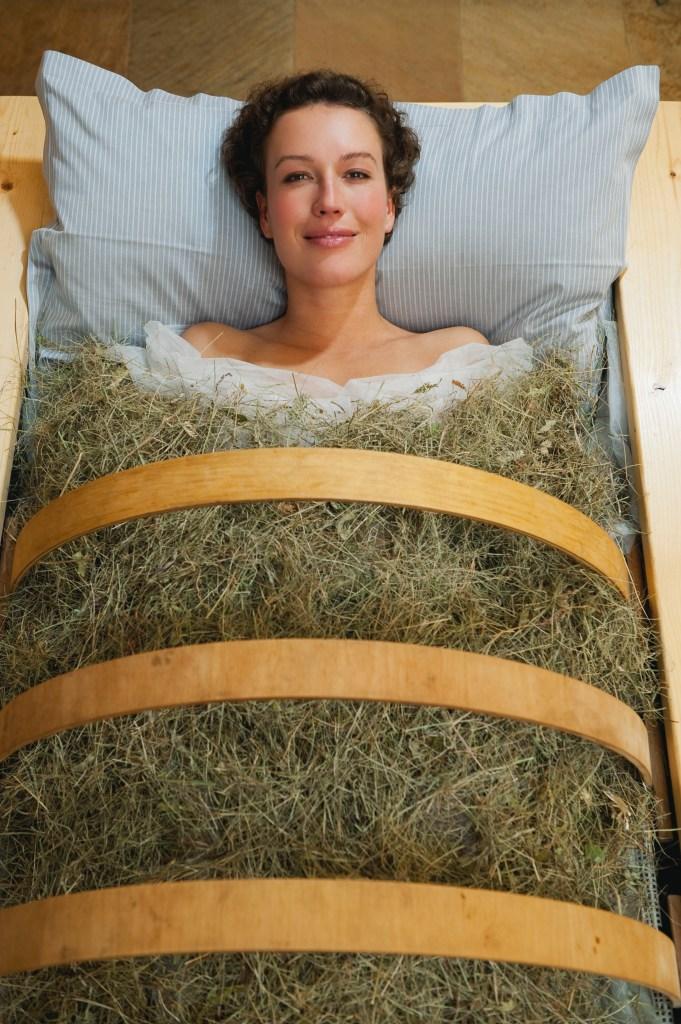 Woman in a hay bath