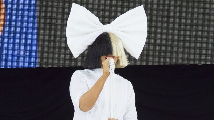 Sia doesn't just hide her face