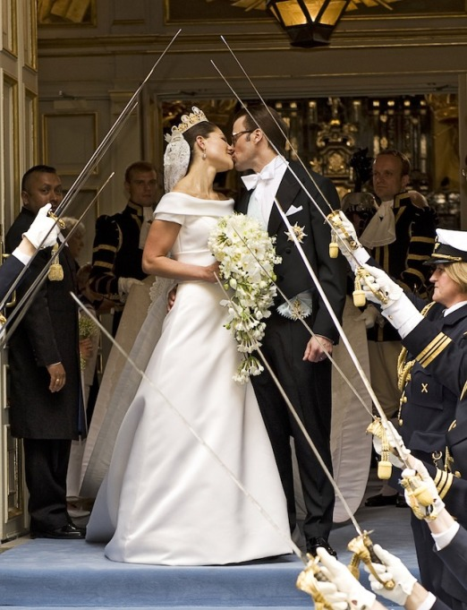 Crown Princess Victoria of Sweden & Prince Daniel of Sweden kiss on their wedding day