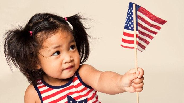 Asian girl holding American flag