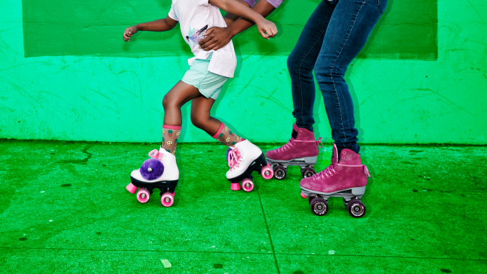 Adult and child rollerskating