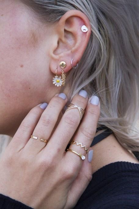 Wearing assorted earrings