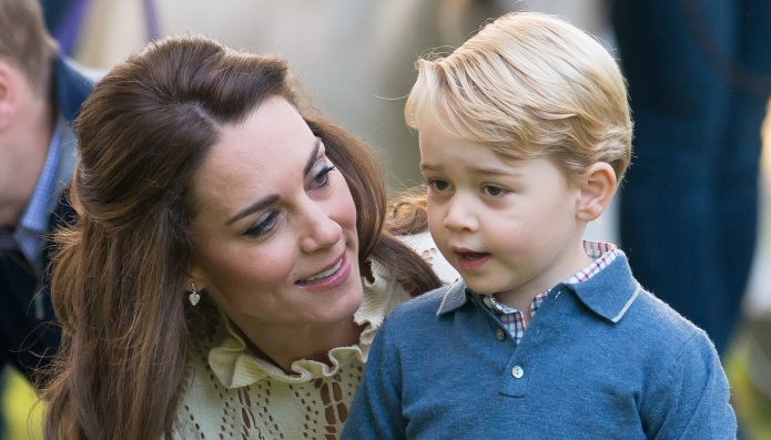 Prince George Plays With a Toy