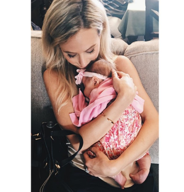 Lauren Bushnell holding a baby