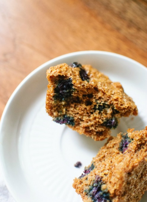 Healthy road trip snacks: blueberry honey bran muffins loaded with fresh blueberries.