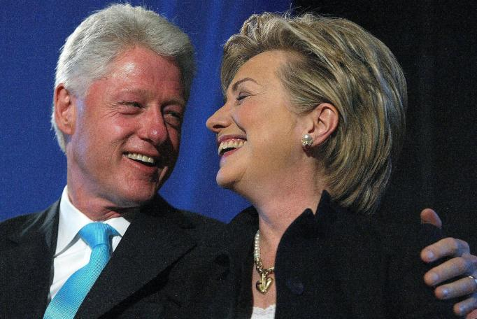 Bill and Hillary Clinton laughing
