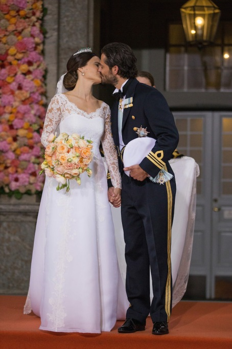 Prince Carl Philip of Sweden & Princess Sofia of Sweden kiss on their wedding day