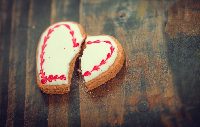 Cracked Heart Shaped Cookie. Breakup Concept