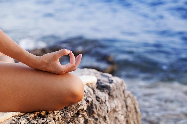 yoga near waves, ohm