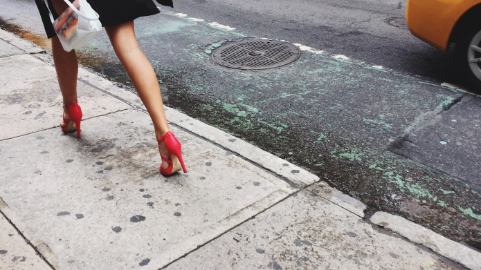 Low Section Of Woman Walking On