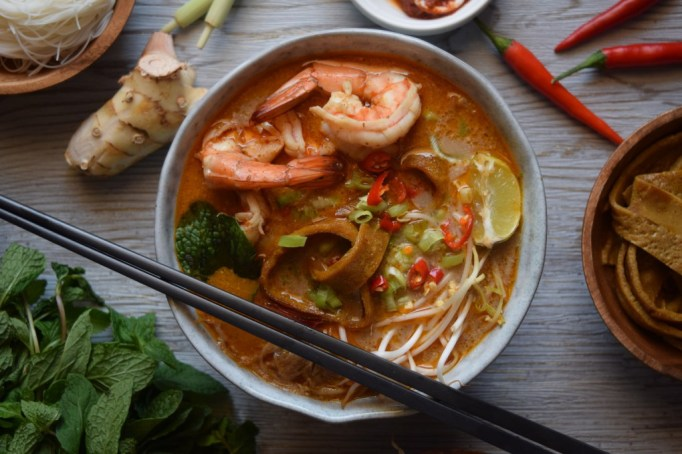 Anthony Bourdain Recipes: Try Tony's recipe for Malaysian kuching laksa, a spicy coconut noodle soup, at home.