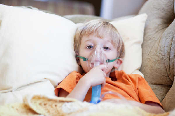 Young boy having breathing treatment